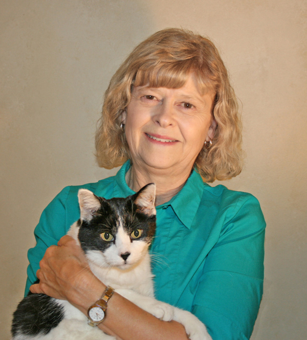 Team member Dr. Aleda with a black and white cat