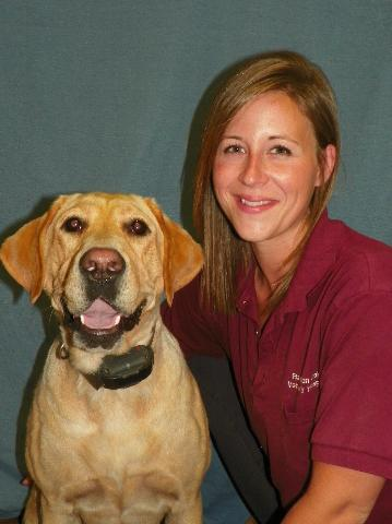 Team member Anna with a yellow Labrador