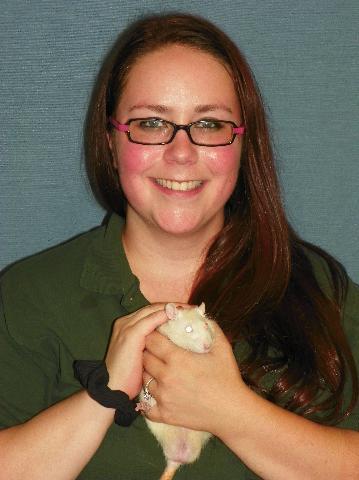 Team member Trinity holding a rat